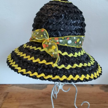 A black straw hat with yellow ribbon.